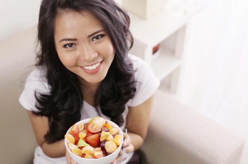 Woman Raw Vegan Holding Fruit